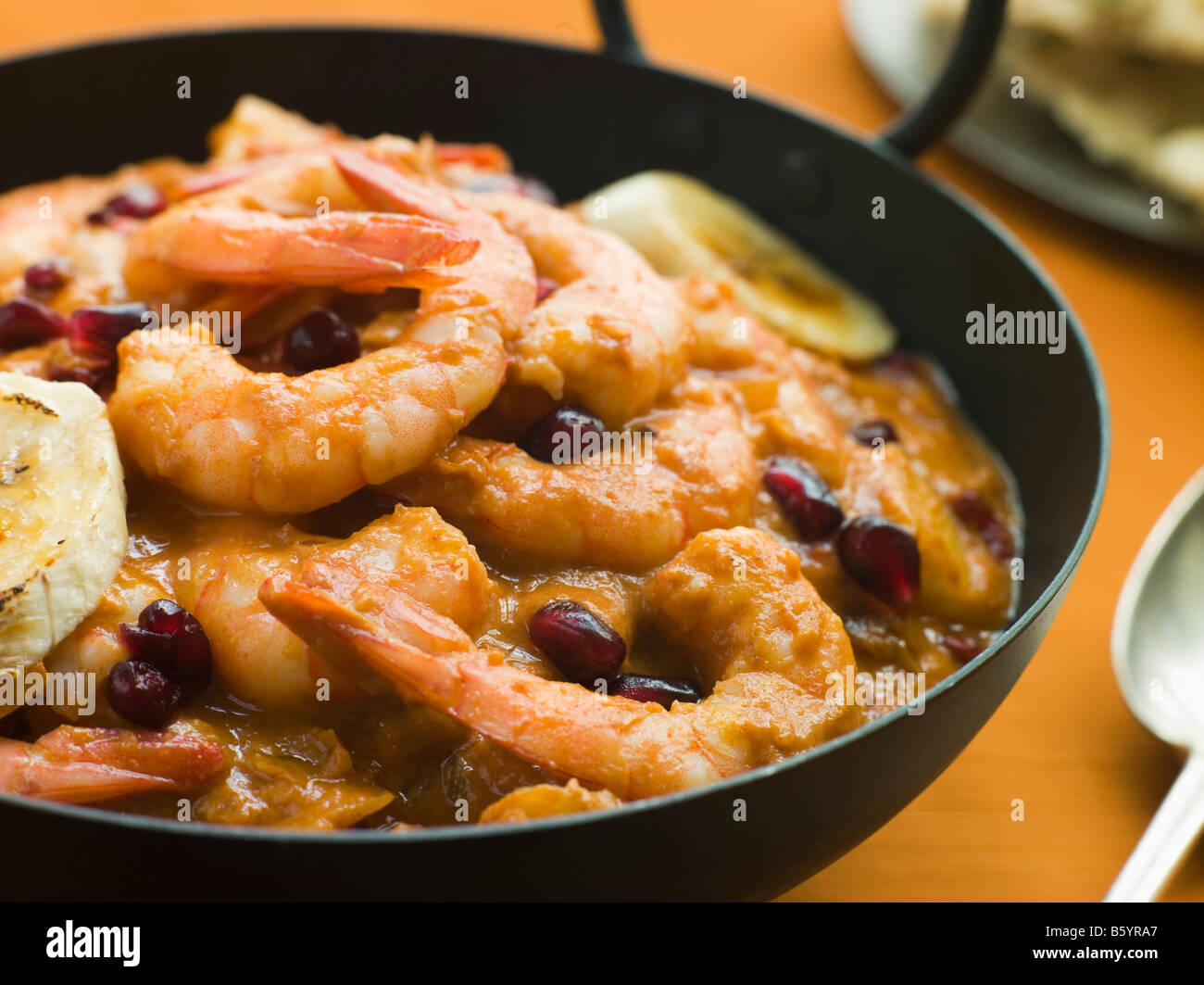 Karahi Dish with Kashmiri Tiger Prawn Curry - Stock Image