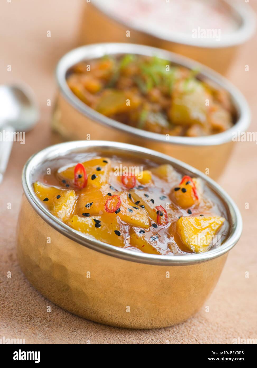 Mango Chutney with Lime Pickle and Raita - Stock Image
