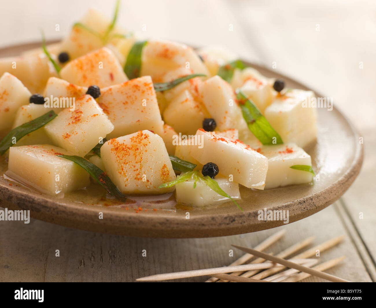 Manchego Marinated in Chili and Tarragon - Stock Image