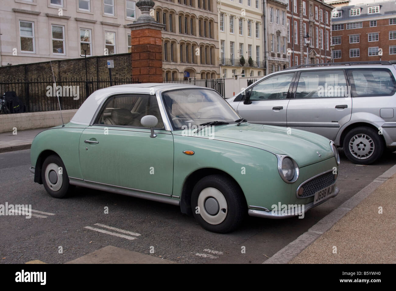 Green and white two tone Nissan Figaro classic cult car - Stock Image