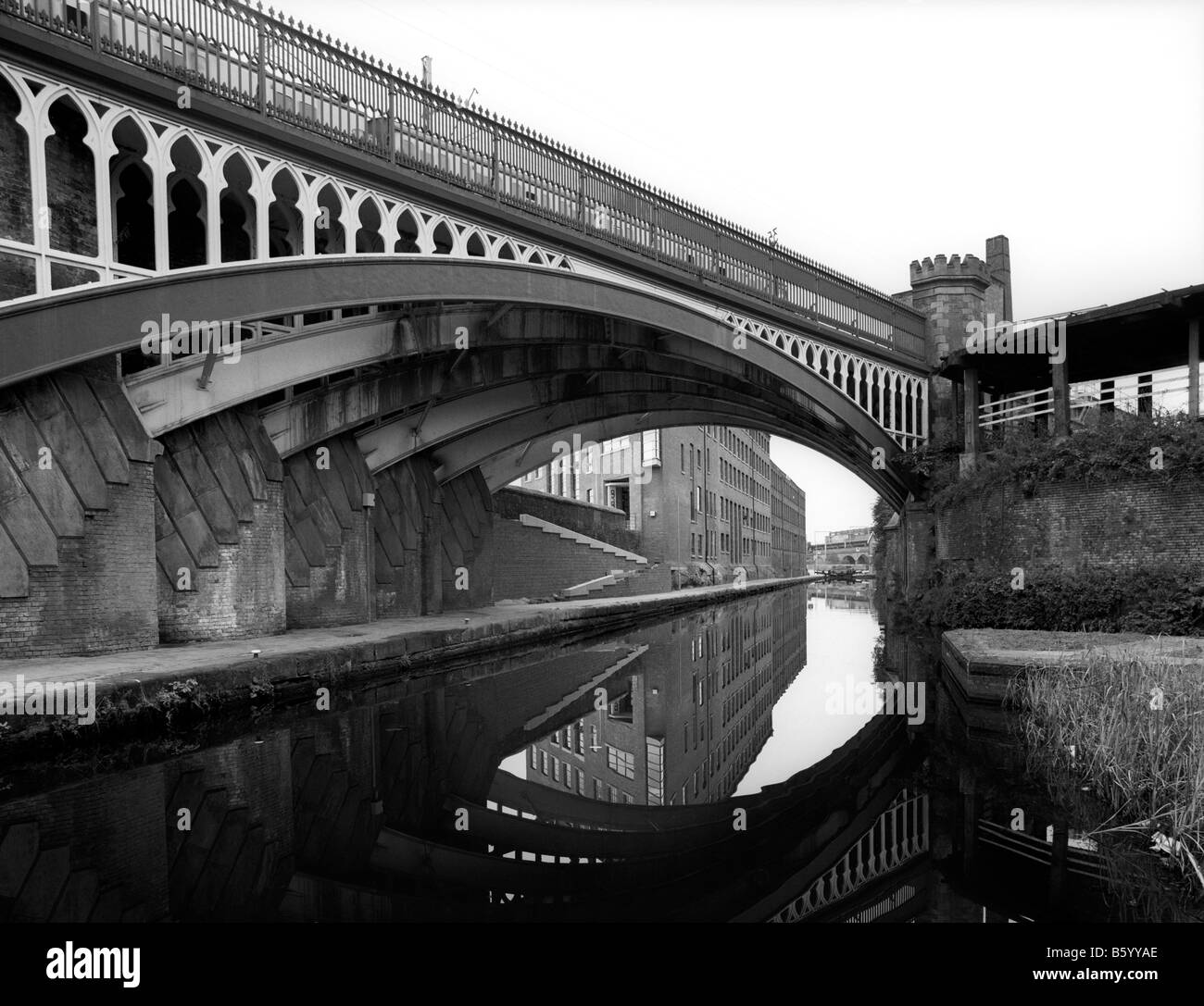 UK England Manchester Castlefield railway bridge over Bridgewater Canal passing through city centre - Stock Image