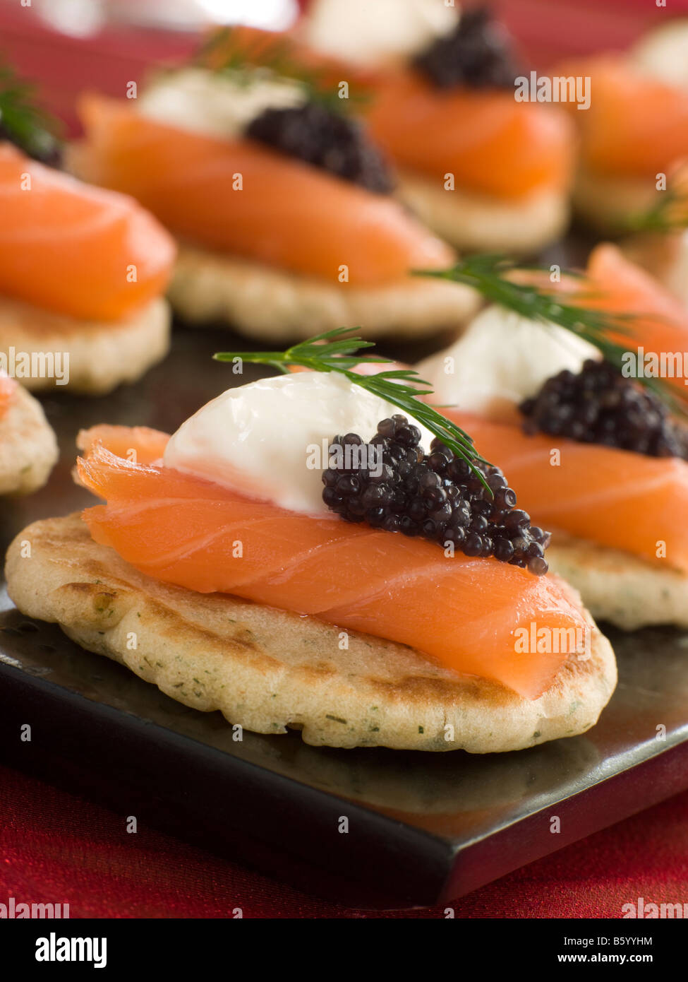 Smoked Salmon Blinis Canap s with Sour Cream and Caviar - Stock Image