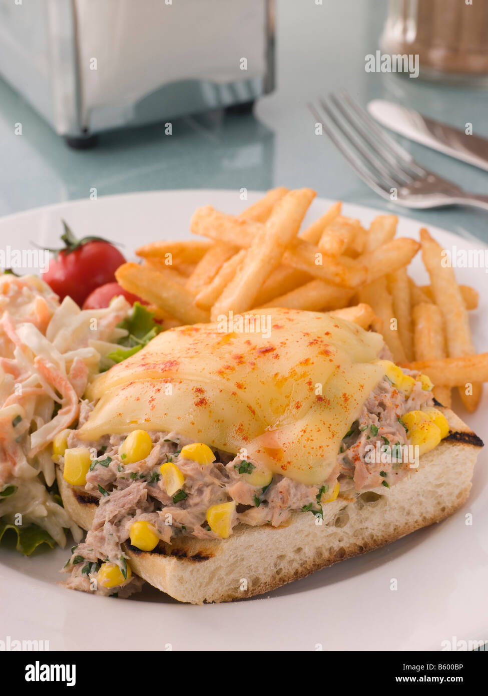 Open Tuna and Sweet corn Melt with Coleslaw and Fries Stock Photo