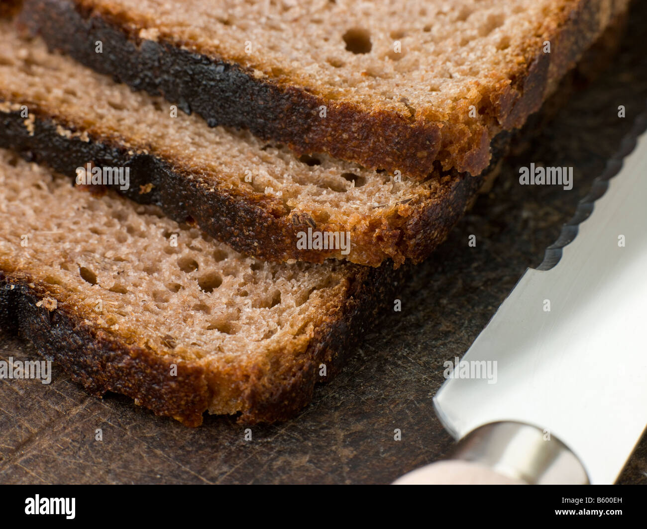 Slices of Rye Bread on a Chopping Board - Stock Image
