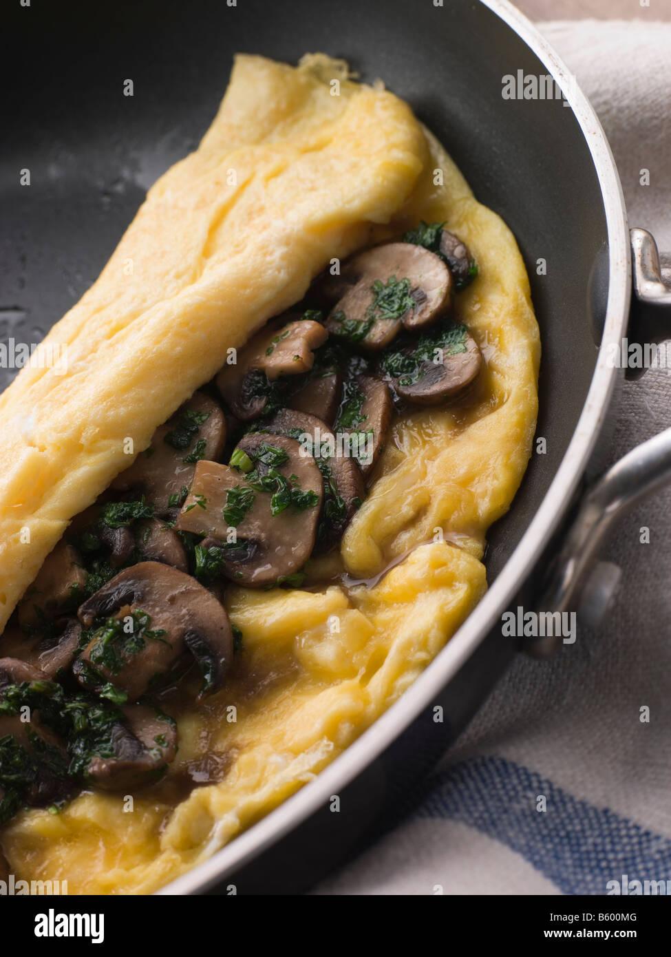 Mushroom Omelette folded in a Omelette Pan - Stock Image