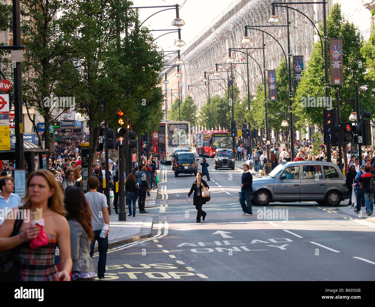 Oxford street shopping district with many people London UK - Stock Image
