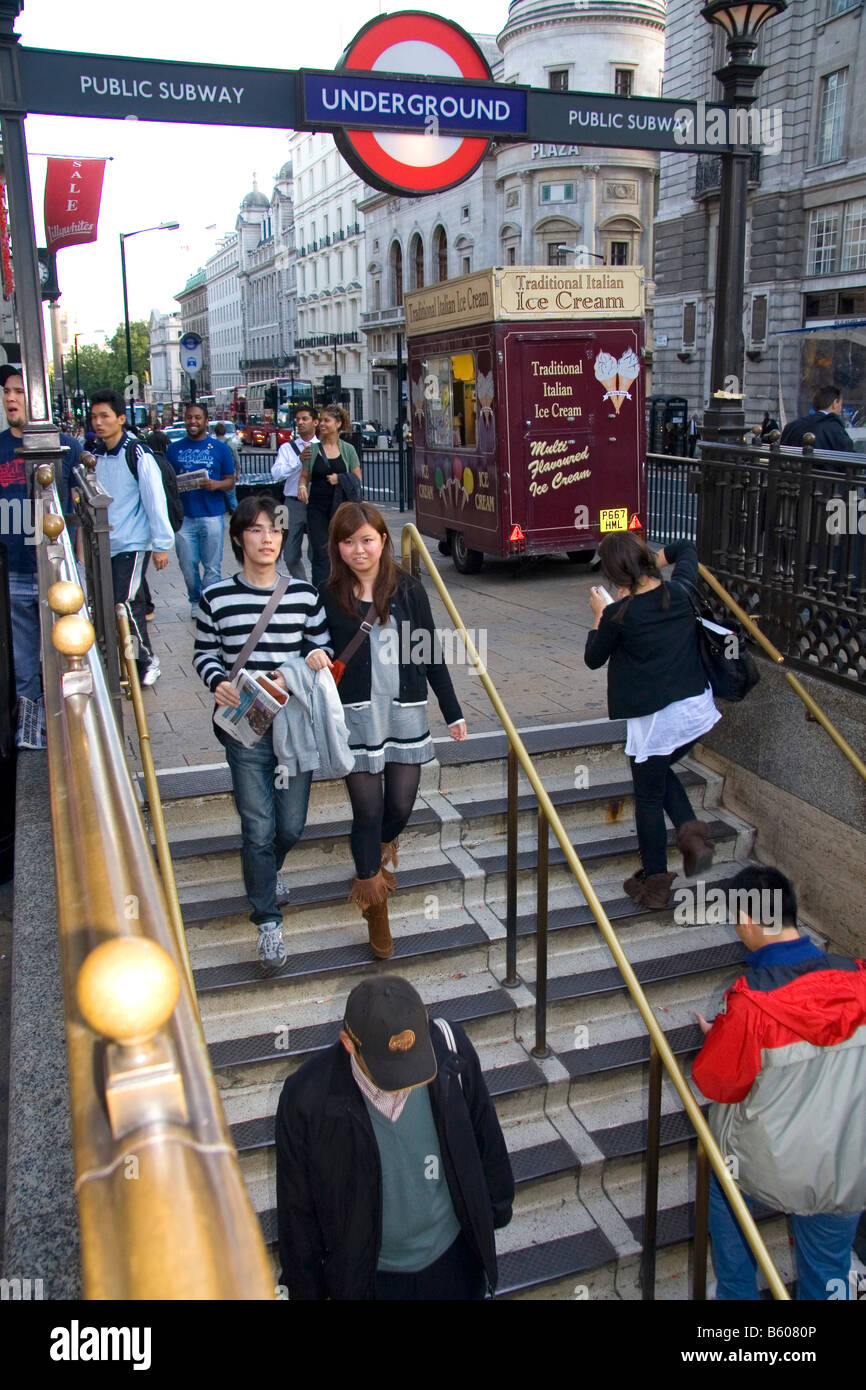 People entering and exiting the London Underground metro system in the city of London England Stock Photo