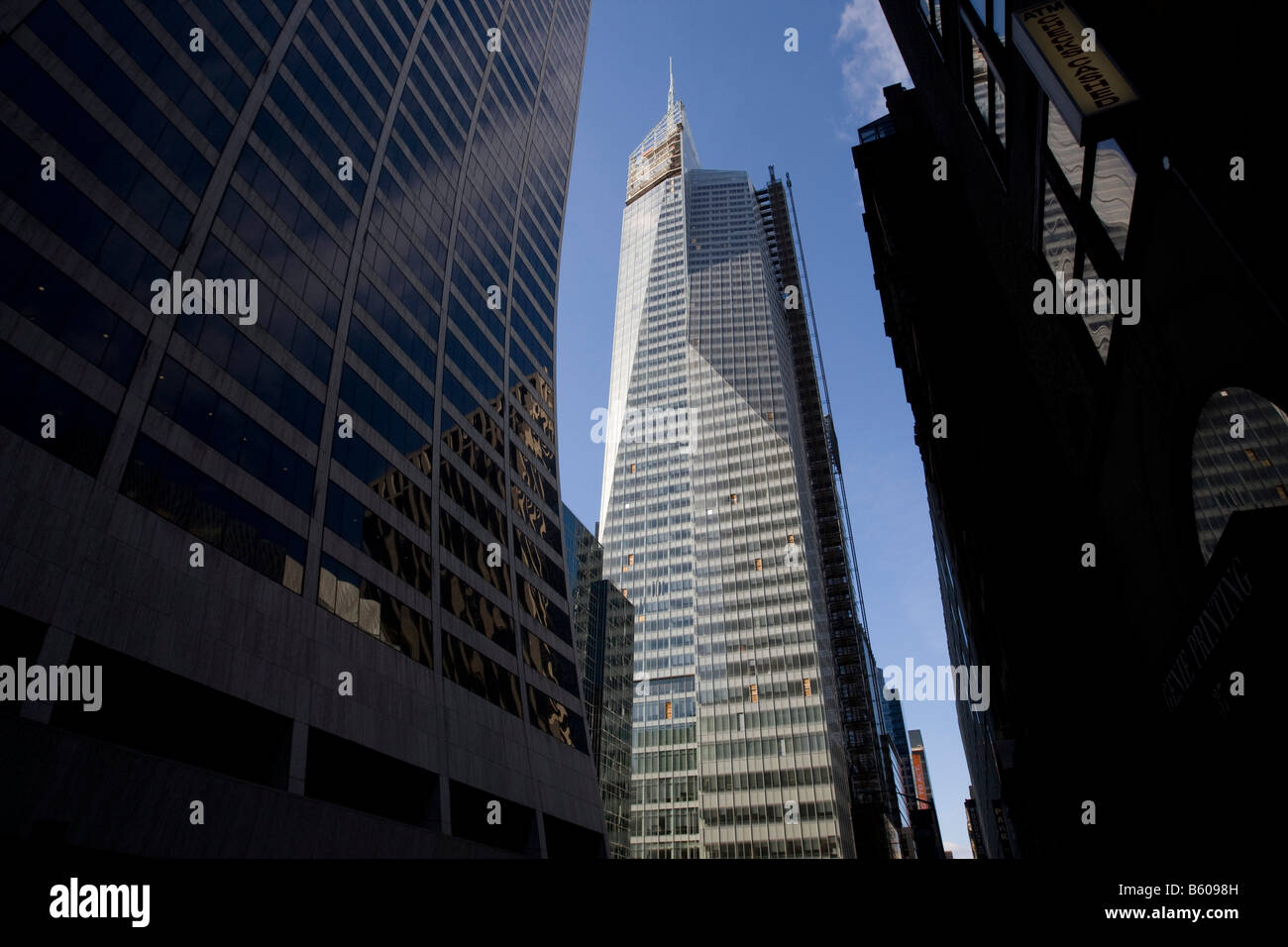 View of new Bank of America Tower under construction at One Bryant Park on Sixth Avenue between 42nd and 43rd Street - Stock Image