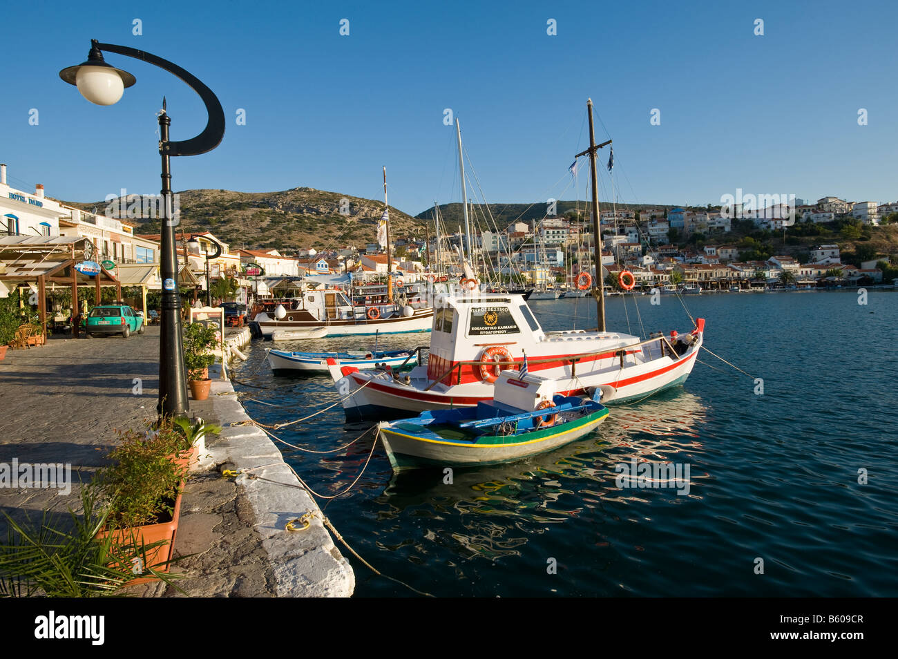 Small fisherman boats in a sunny and picturesque harbour. Stock Photo