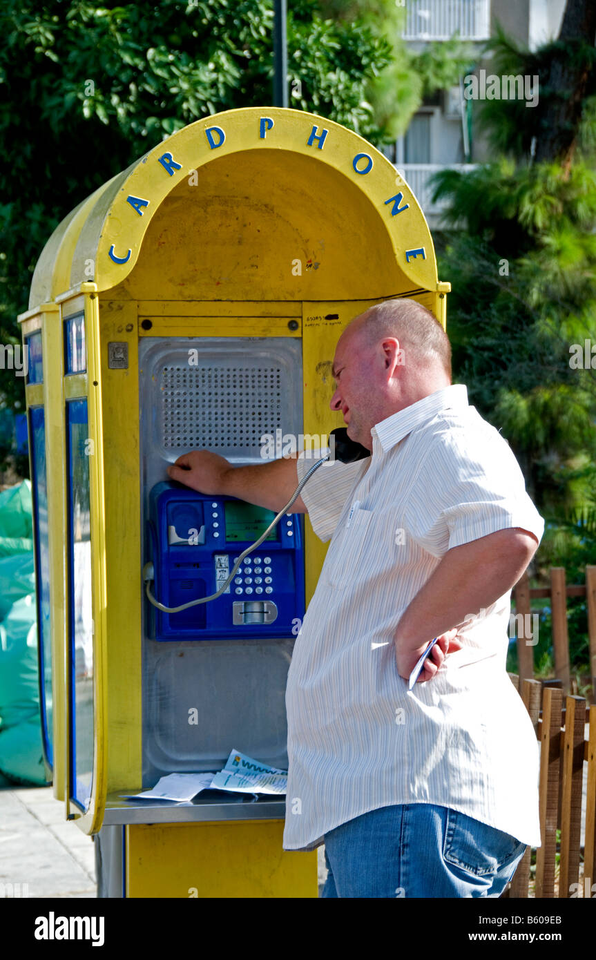 Athens Cardphone person Phone booth box telephone connecting Athens Greek Greece - Stock Image