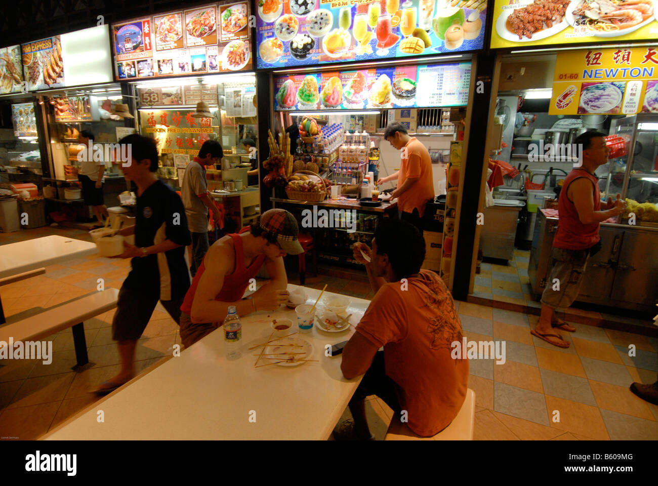 Two Men Have Dinner At Newton Circus Food Court In Singapore Deux