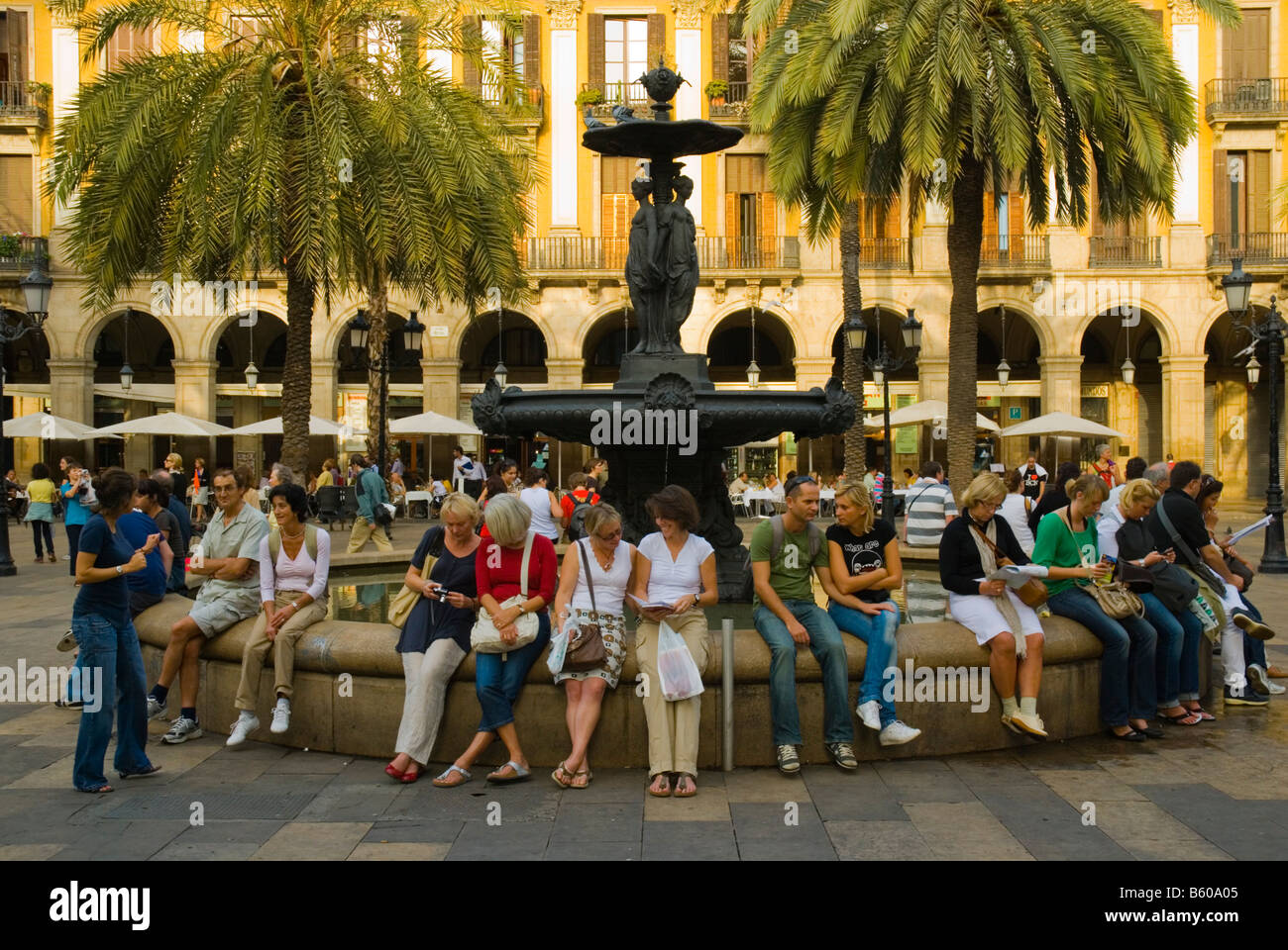 People at the fountain at Placa Reial in central Barcelona Spain Europe - Stock Image