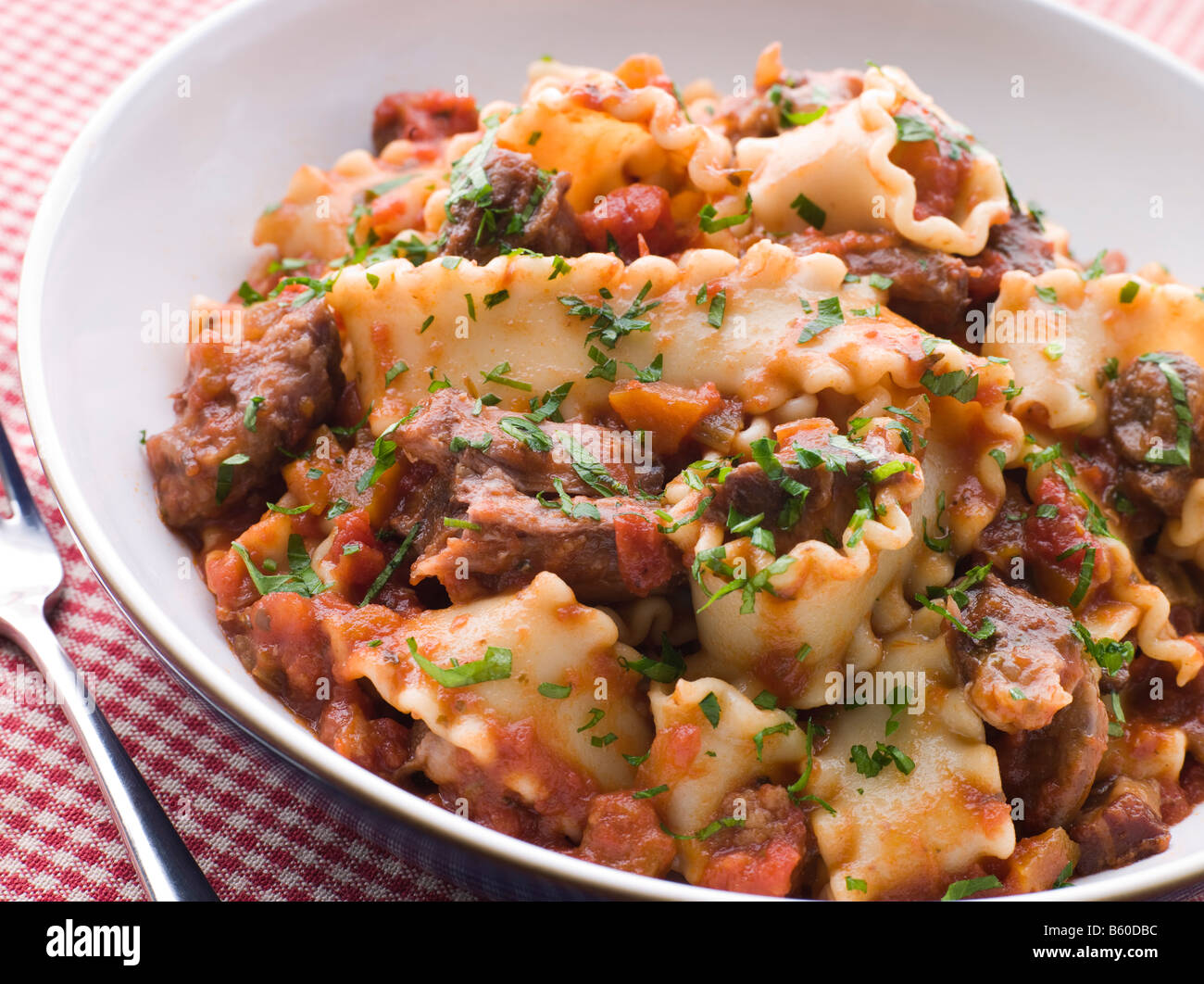Strips of Fillet Steak in a Chilli Tomato Sauce with Trompetti Pasta - Stock Image