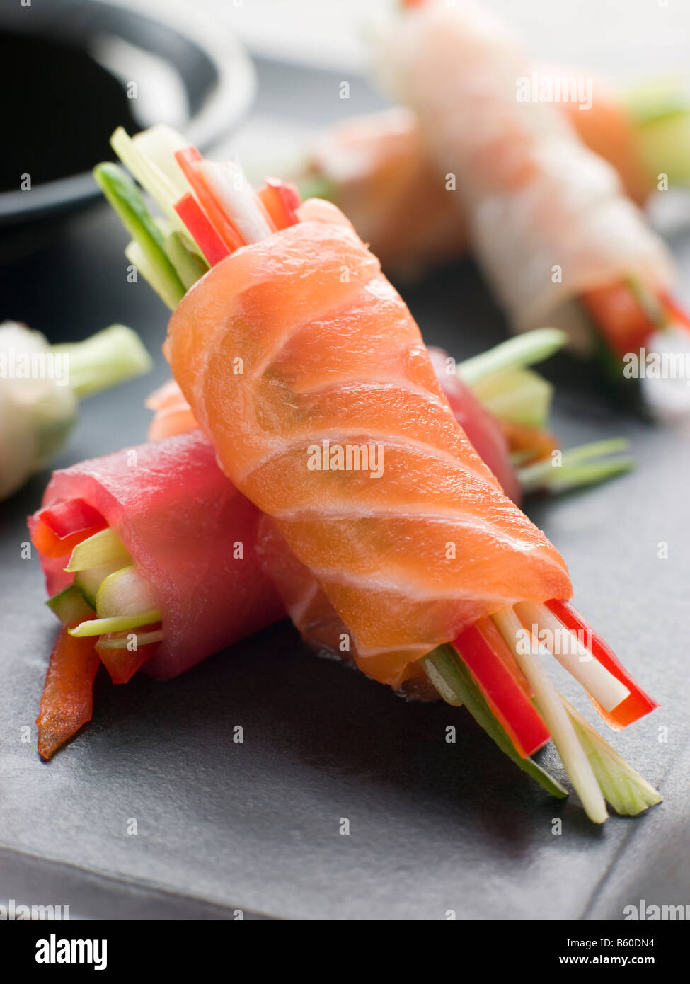 Sashimi and Vegetable Rolls with Soy Sauce - Stock Image