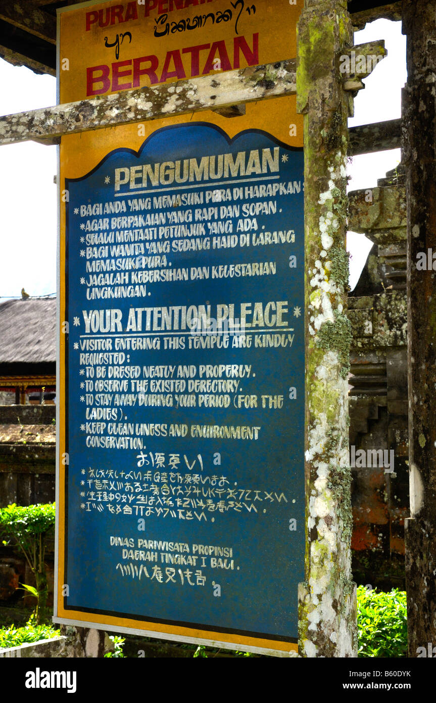 Information sign, including stay away during your period, Pura Ulun Danu Temple on Bratan Lake, Bali, Indonesia - Stock Image