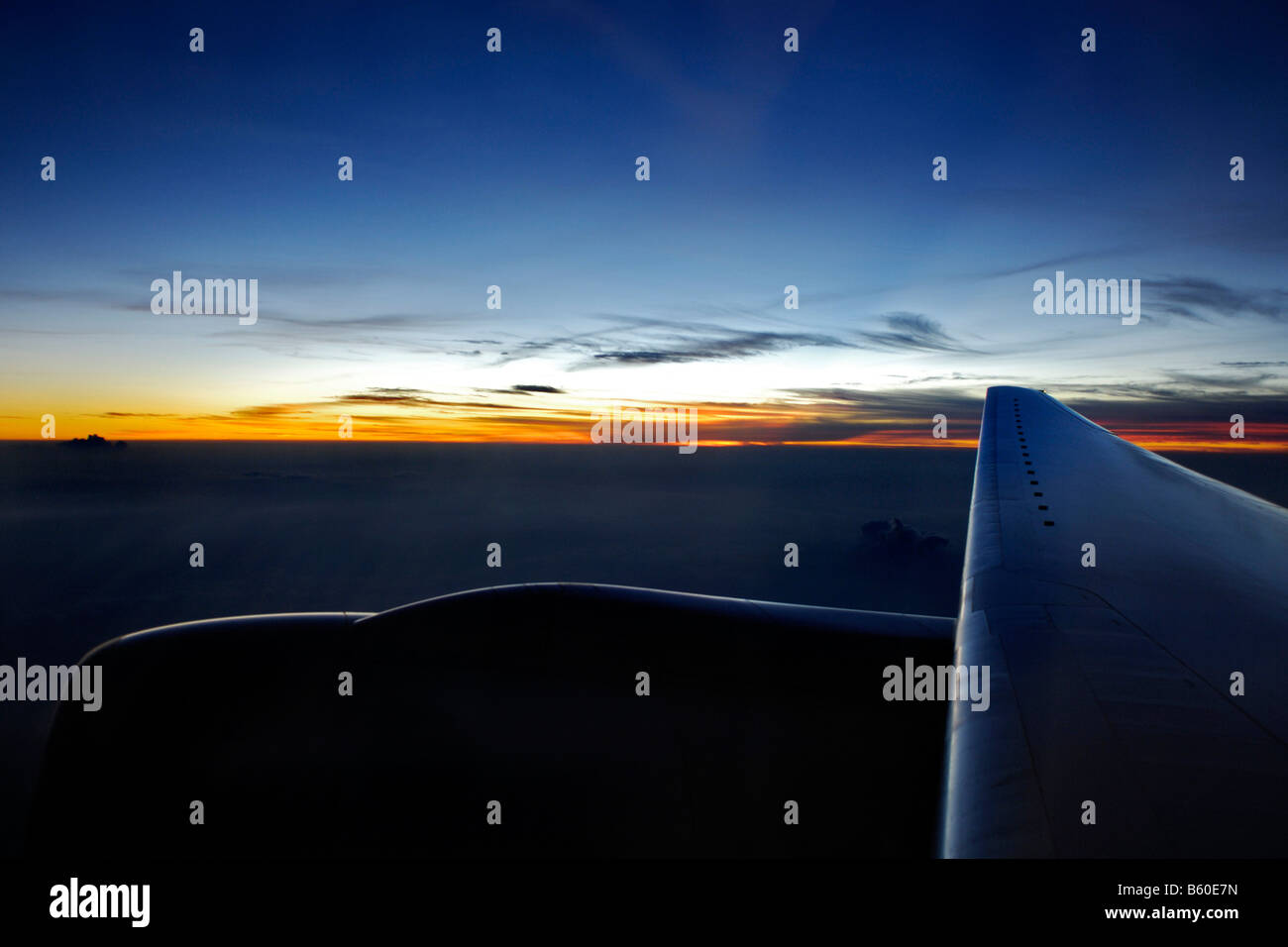 Sunset, view from window of an airplane near Singapore, Singapore, Asia - Stock Image