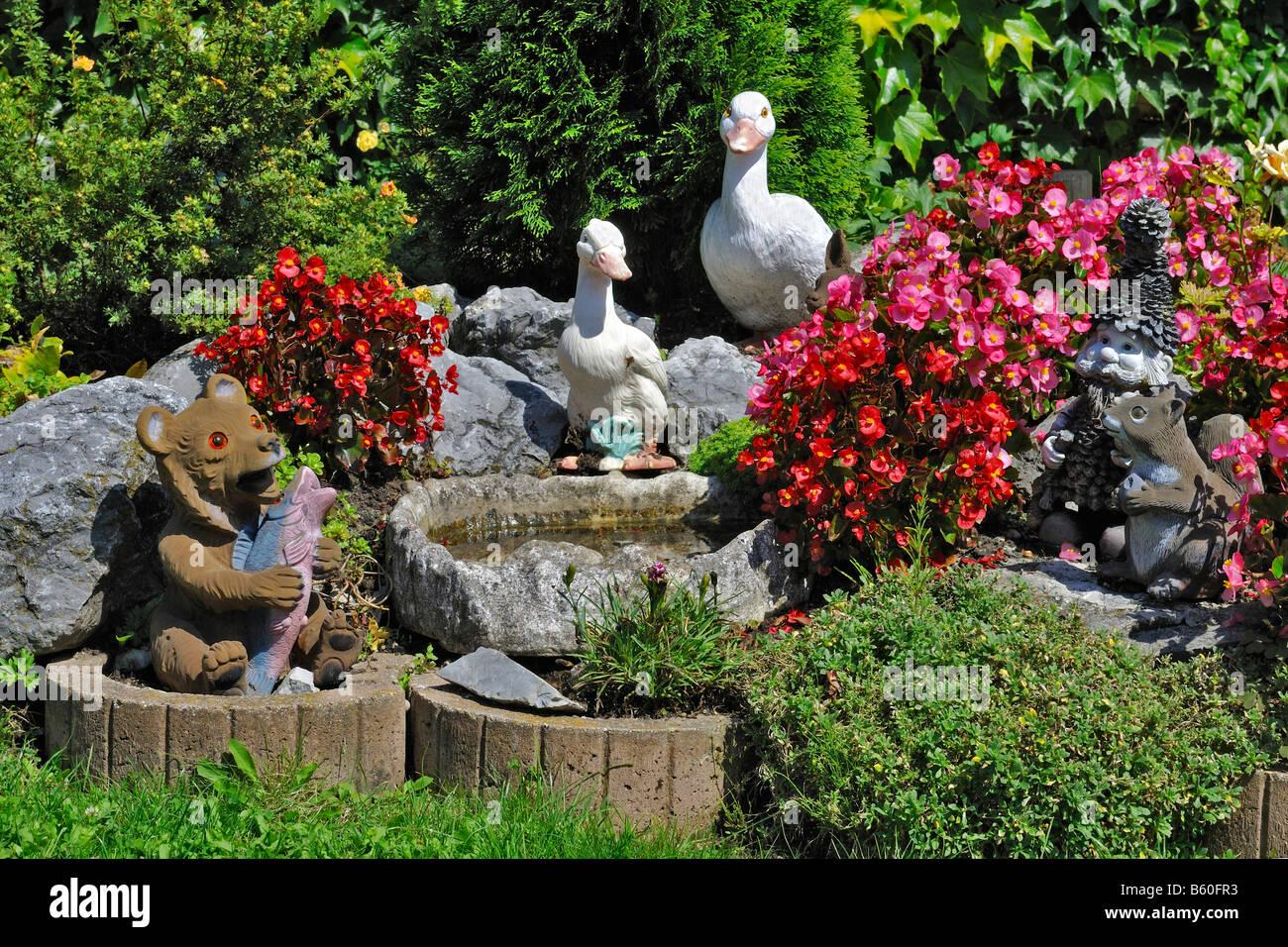 garden gnomes and figurines of ducks squirrels and a bear in a bavarian garden near - Garden Figurines