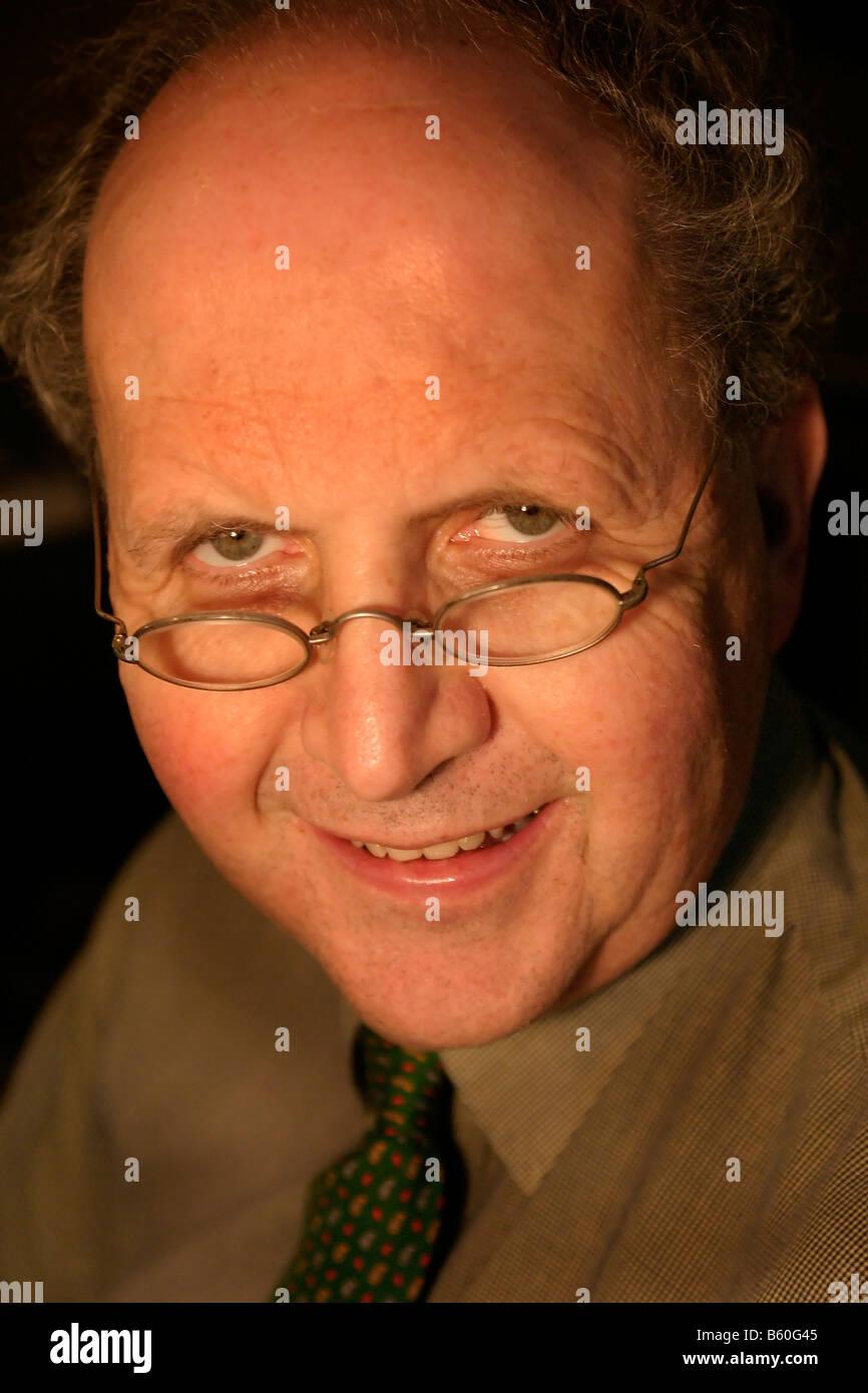 Scottish Author ALEXANDER MCCALL SMITH in his Edinburgh home - Stock Image