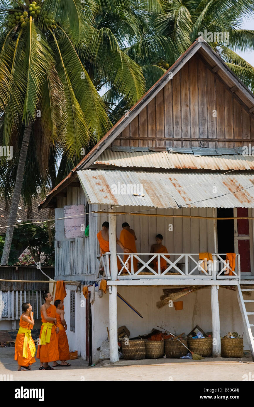 Young monks enjoying their spare time, Luang Prabang, Laos, Asia - Stock Image