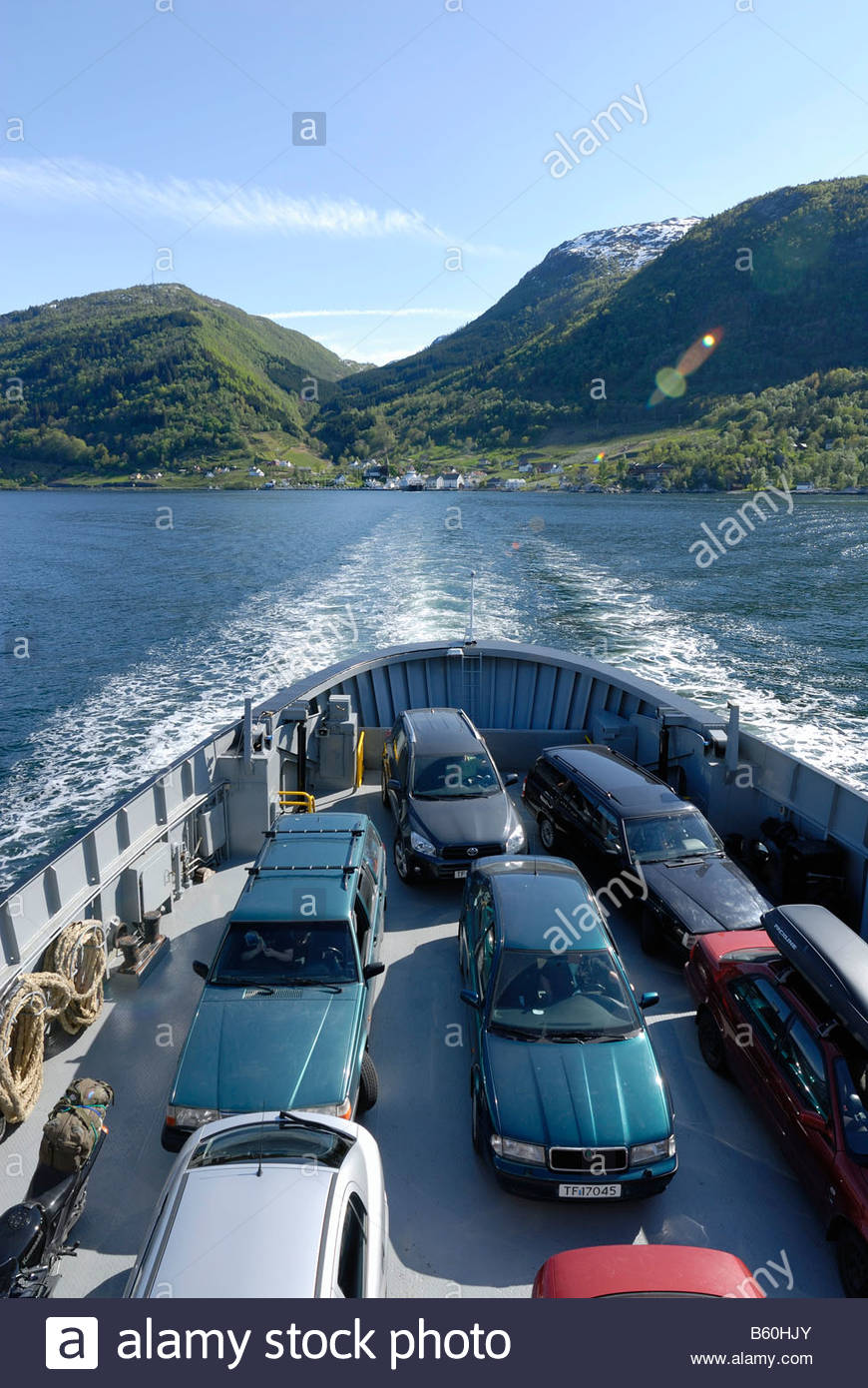 Ferry ride on Hardangerfjord from Utne to Kvanndal, Utne Village at back, Hordaland County, Norway, Scandinavia, - Stock Image