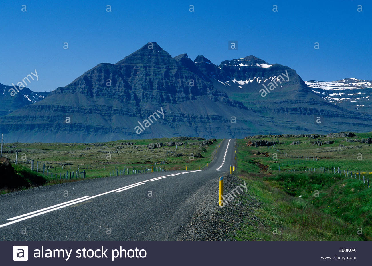 Orbital road east of the fishing village Djupivogur in the Eastern Fjords, typical basalt mountains of the Eastern - Stock Image