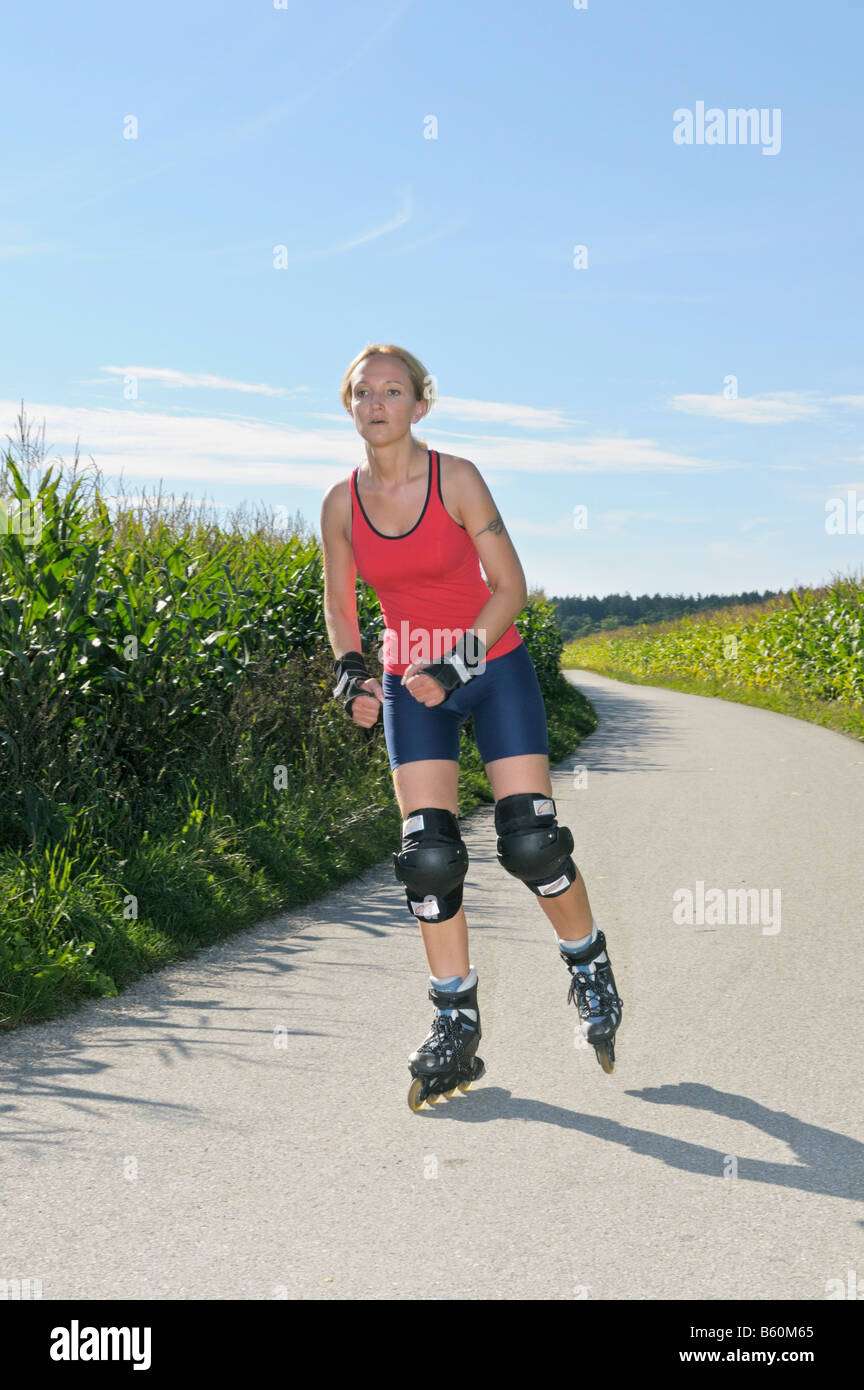 Young woman roller blading - Stock Image