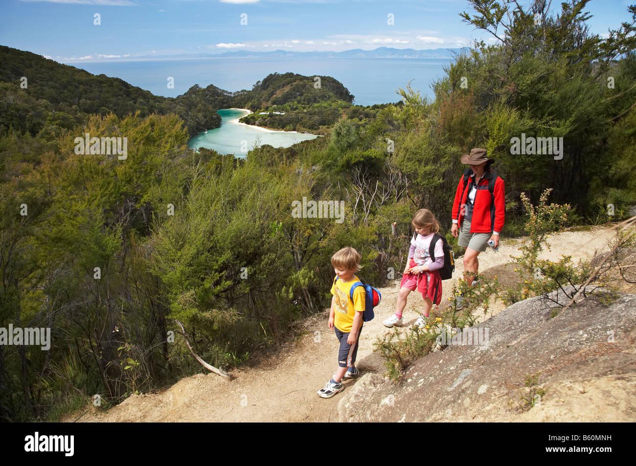 Family Walking the Abel Tasman Coastal Track above Frenchman Bay Abel Tasman National Park Nelson Region South Is - Stock Image