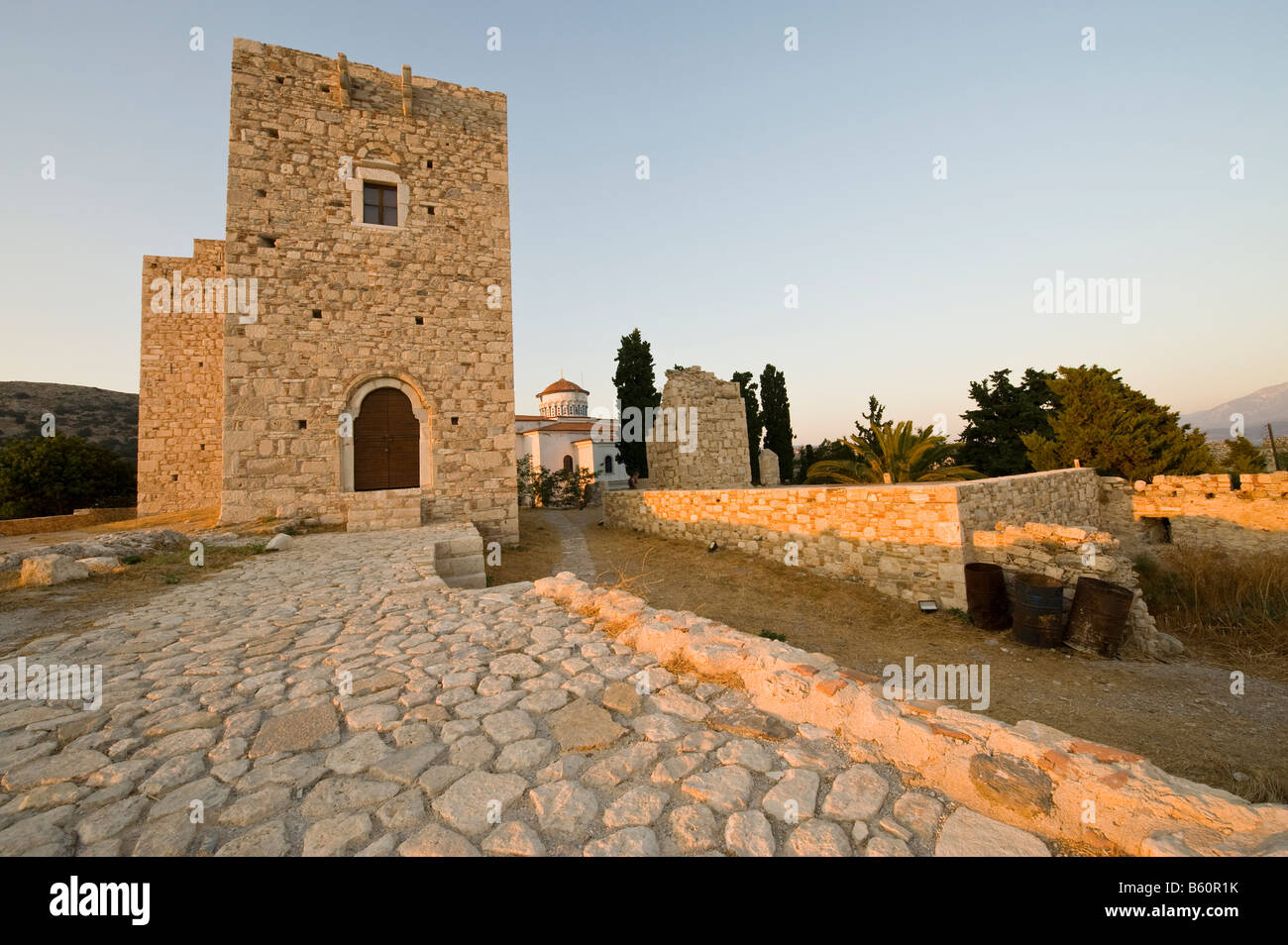 Castle and church in the light of the evening sun on a greek island Stock Photo