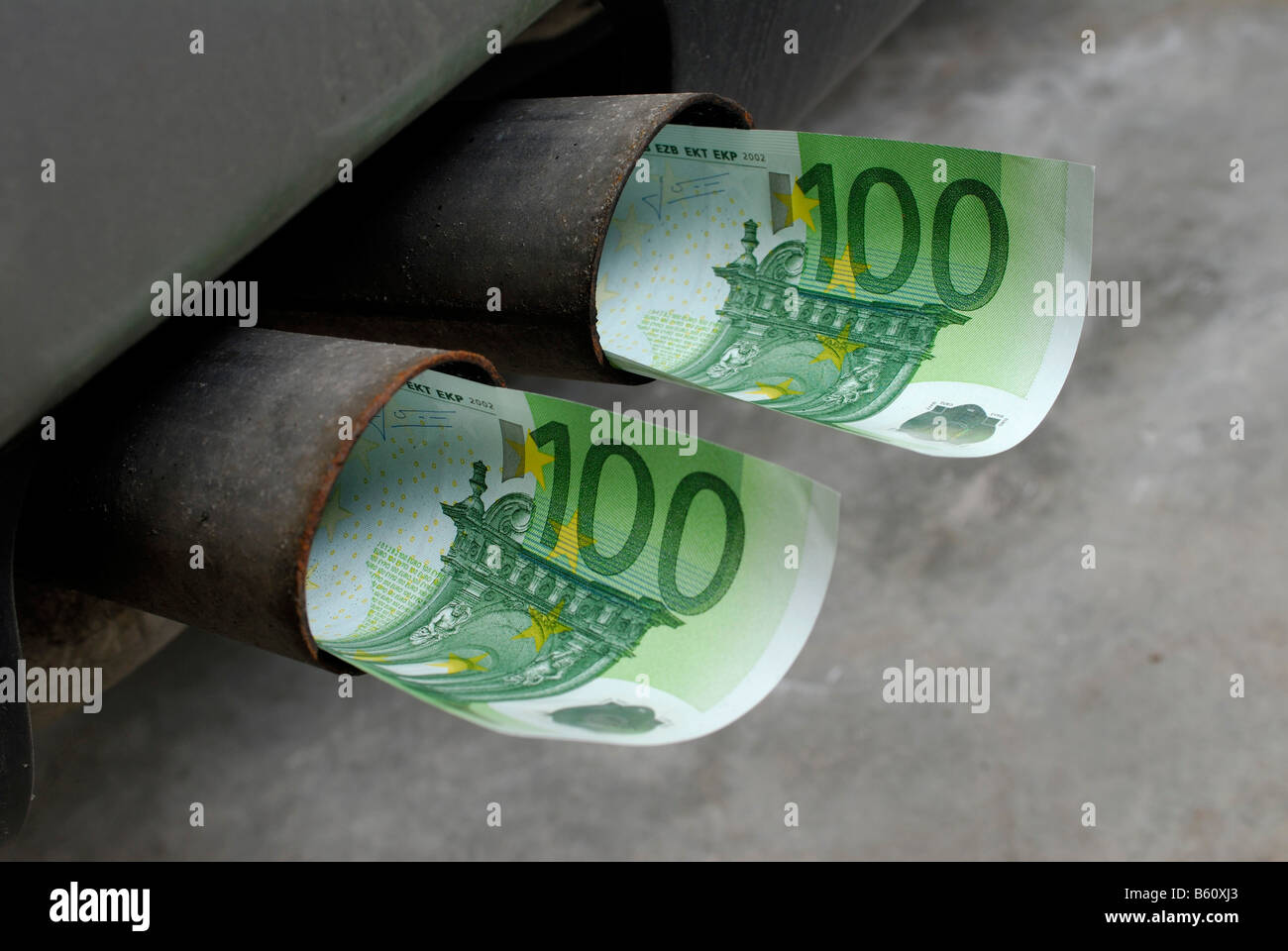 Cash Notes In A Car S Exhaust Pipe Symbolic Image For Increased Car