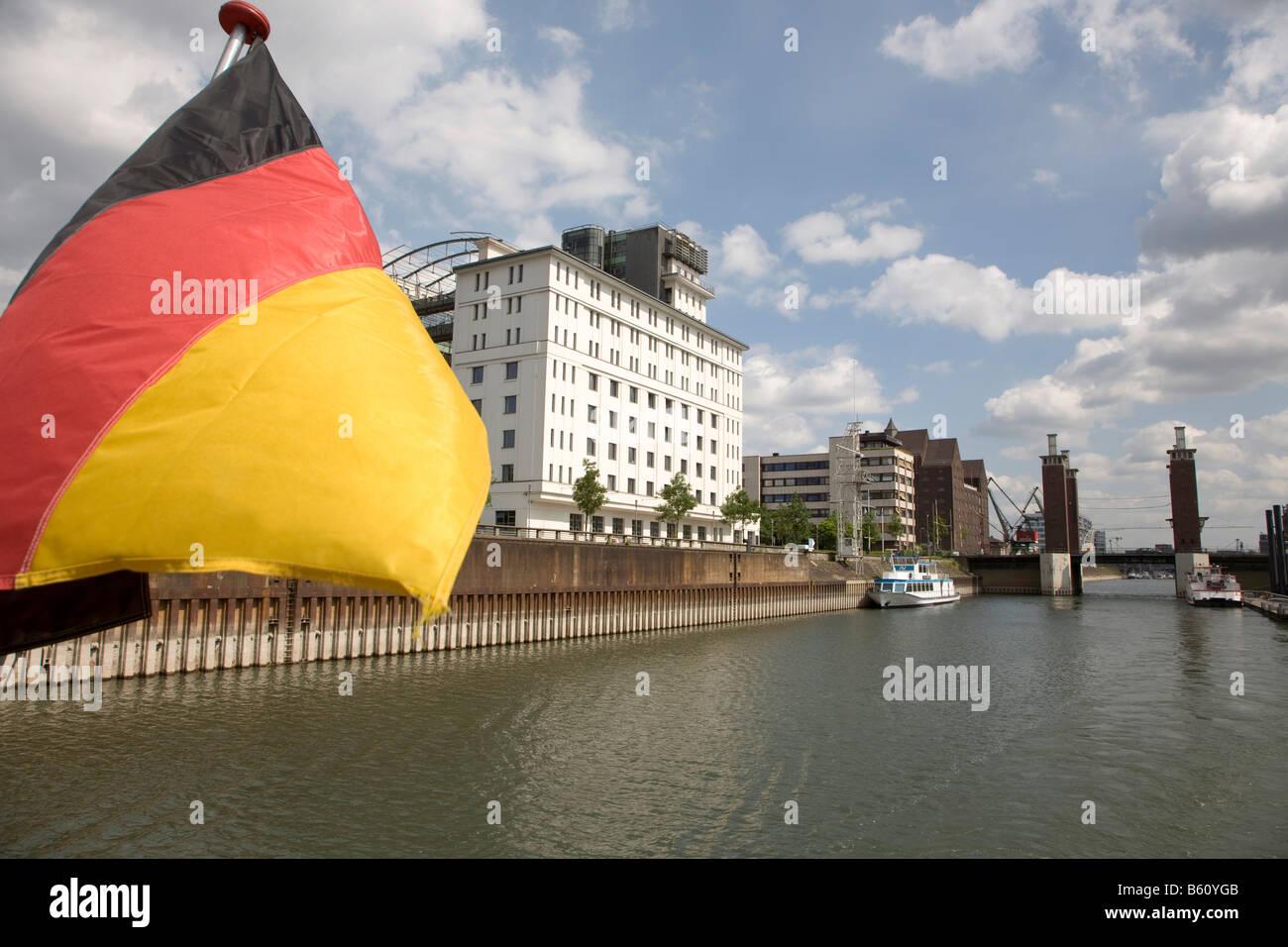 Flag of Germany in front of the Kontorhaus, basin, Duisburg, North Rhine-Westphalia - Stock Image