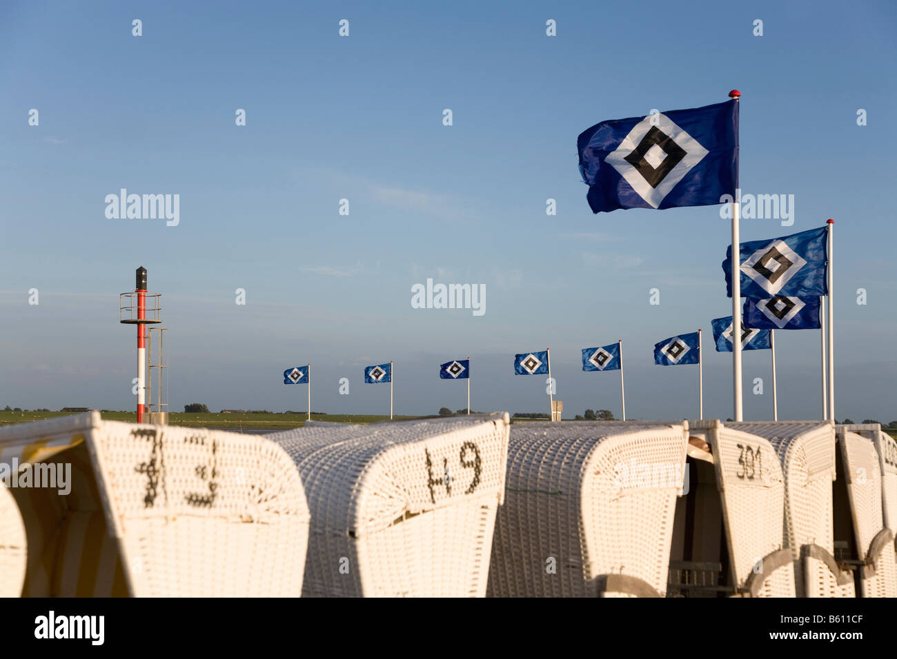 Flags of the Hamburger Sport Verein, or HSV, being flown over roofed wicker beach chair as part of the campaign, - Stock Image