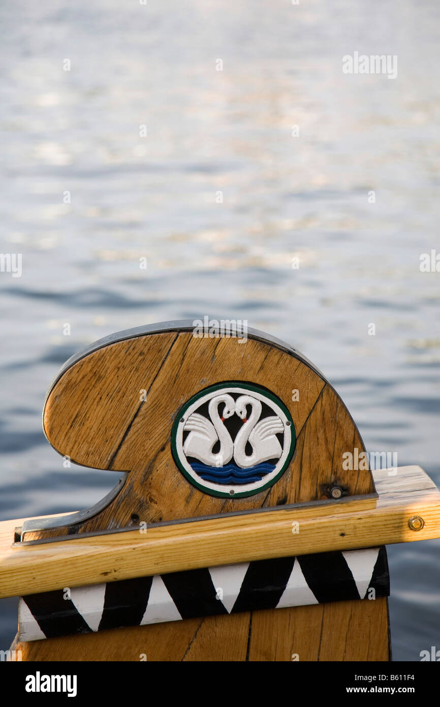 Two white swans forming a heart shape decorate a wooden bow at the Flensburg Nautics sailing festival, Flensburg Stock Photo