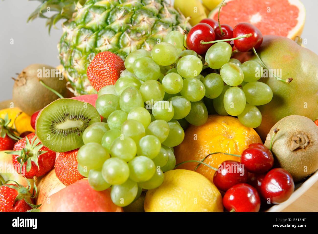Fresh fruit rich in vitamins in a bowl - Stock Image