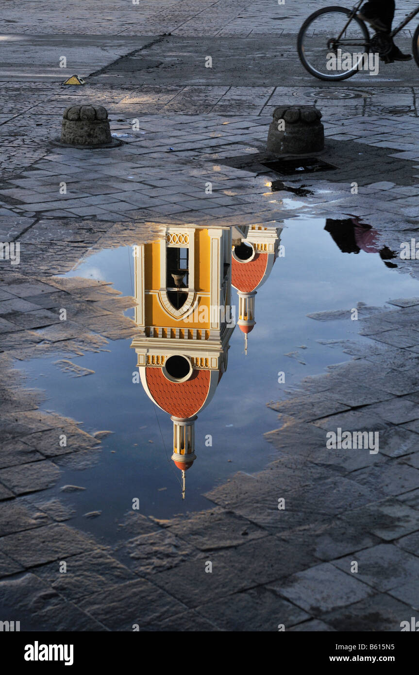 Cathedral Tower reflected in a puddle, Granada, Nicaragua, Central America - Stock Image