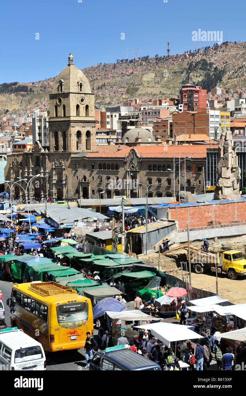 Traffic chaos, market stalls and the Franciscan Church, La Paz, Bolivia, South America - Stock Image
