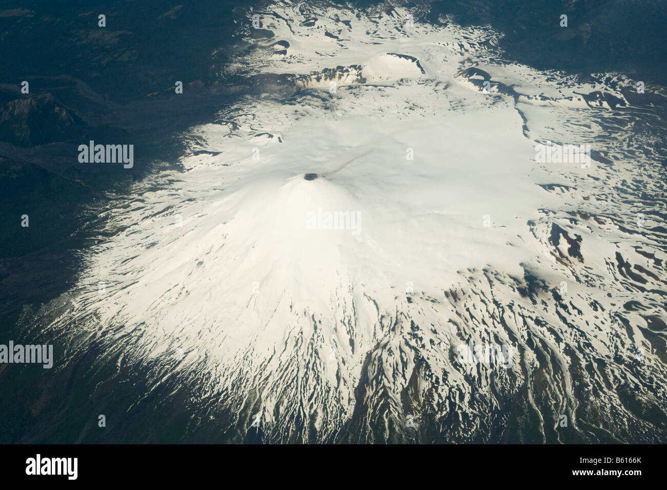 Volcan Villarica, Aerial, 2840m Villarica National Park, CHILE : Shot from commercial plane window  so image is - Stock Image