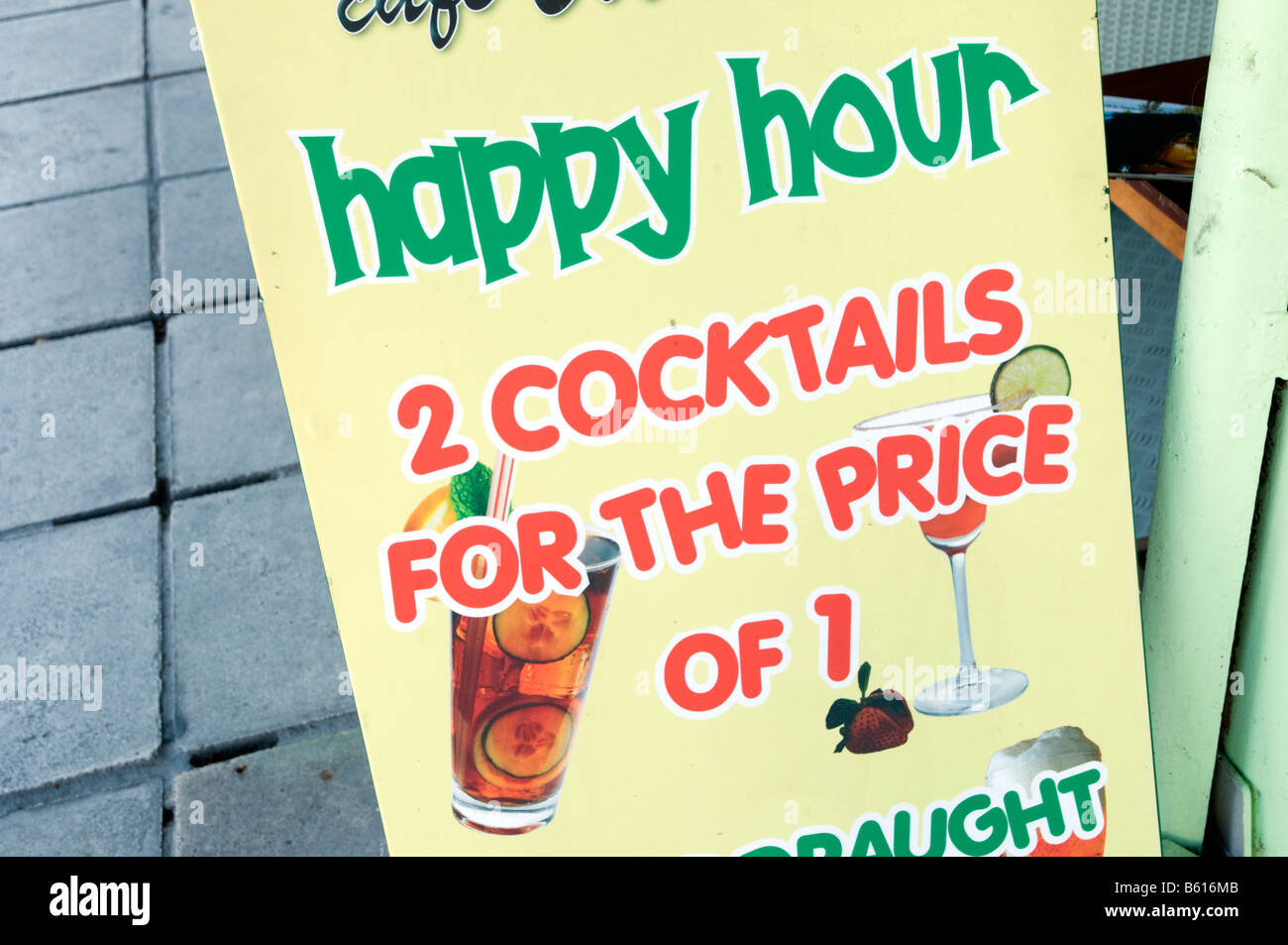 Happy hour sign outside English bar - Stock Image