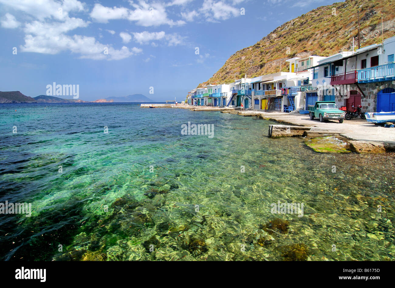 Fishing village of Klima with green sea water on Milos, Cyclades, Greece, Europe - Stock Image