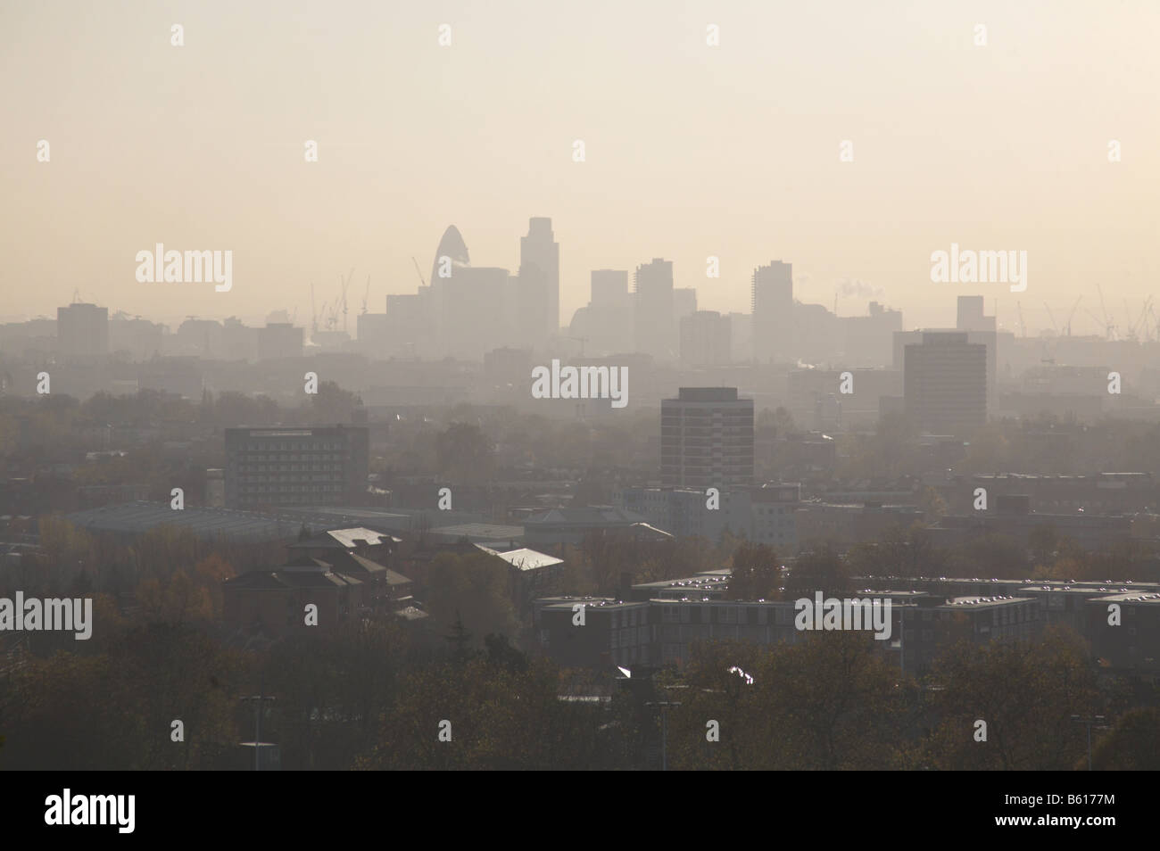 smoggy smog haze of pollution hanging over London England UK - Stock Image