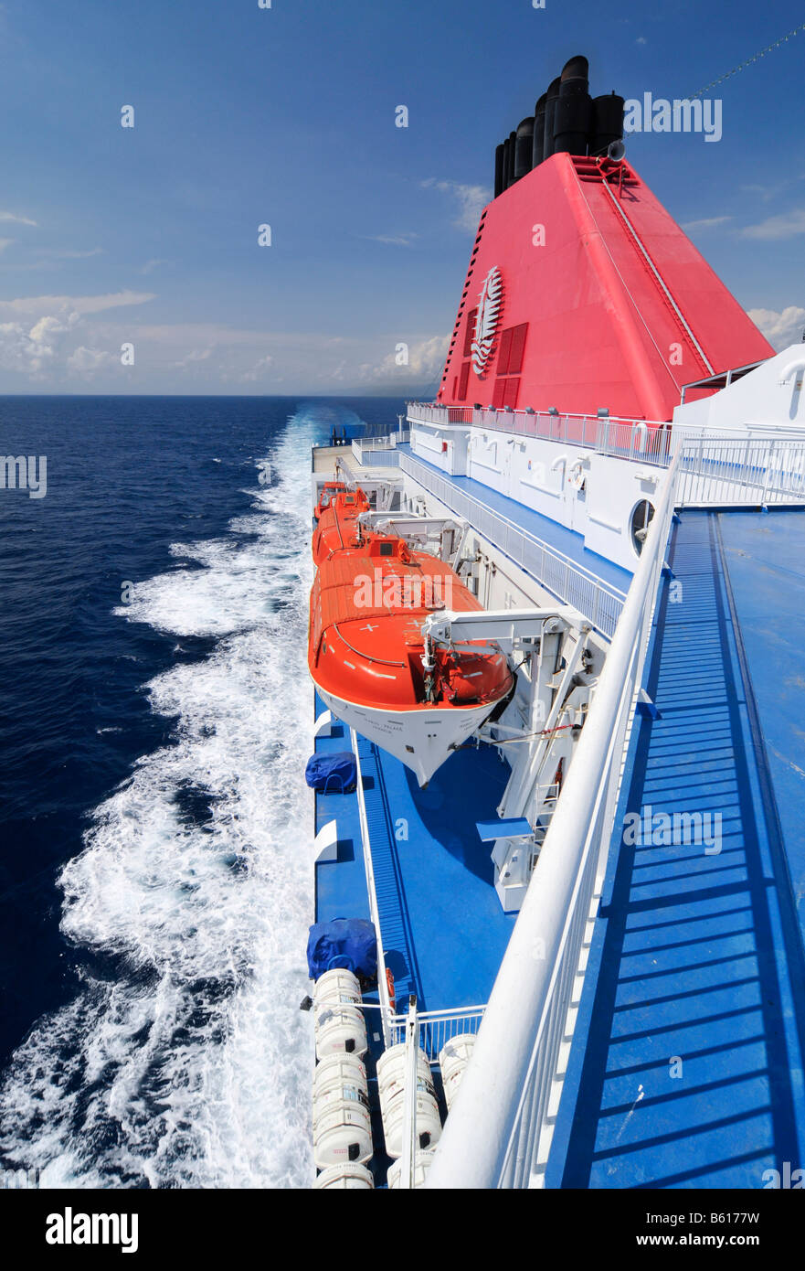 Lifeboats suspended on the side of a car ferry at sea, Mediterranean, Europe - Stock Image