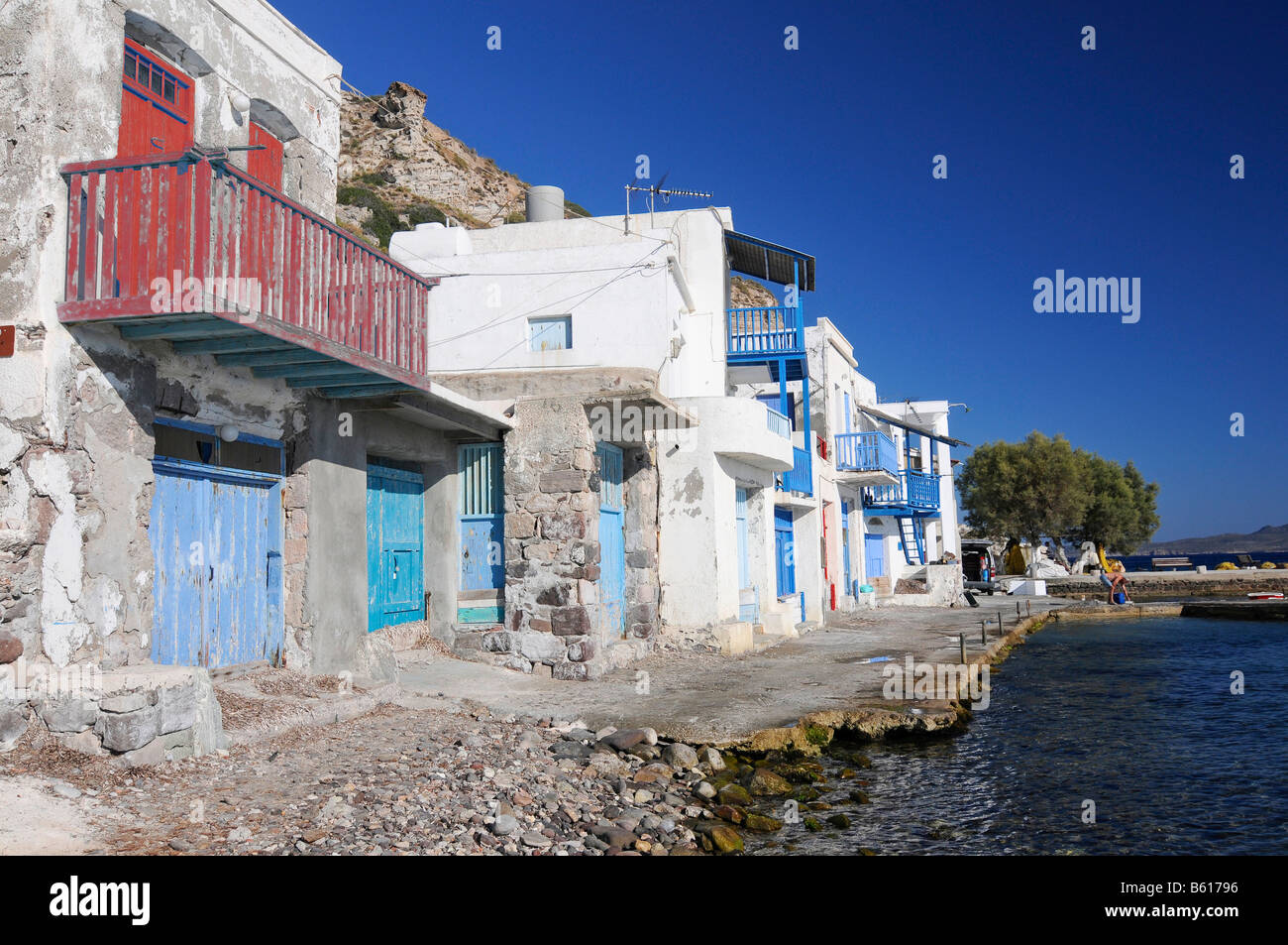 Colourful houses beside the ocean of the fishing village of Klima on Milos Island, Cyclades Island Group, Greece, - Stock Image