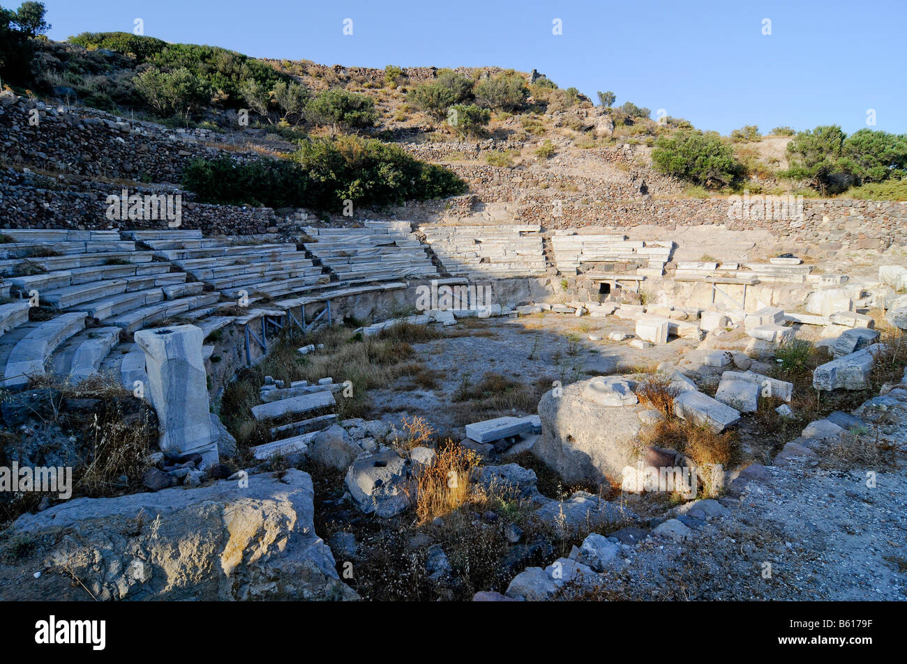 Antique stone amphitheatre of Melos on the Island of Milos, Cyclades Island Group, Greece, Europe - Stock Image