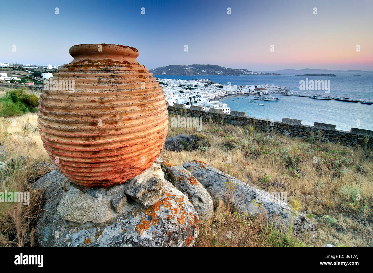 Antique clay vase in front of the old port of Mykonos, Cyclades, Greece, Europe - Stock Image