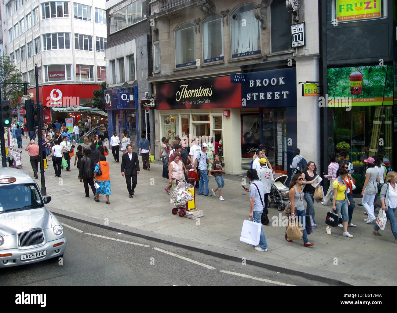 Shoppers in Oxford Street london GB UK - Stock Image
