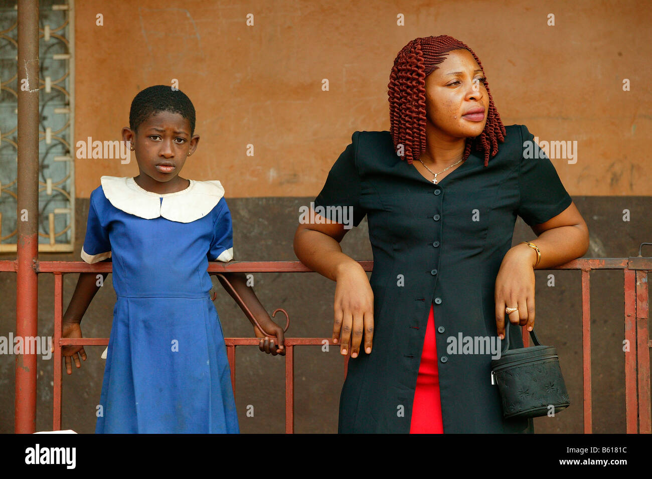 Contemporary African woman standing with a girl in a school uniform, Women's Education Centre, Bamenda, Cameroon, - Stock Image