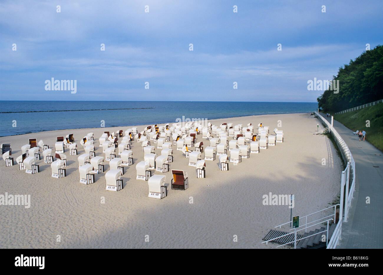 Deserted Baltic Sea beach near Sellin with roofed wicker beach chairs, pre-season, Ruegen Island, Mecklenburg-Western - Stock Image