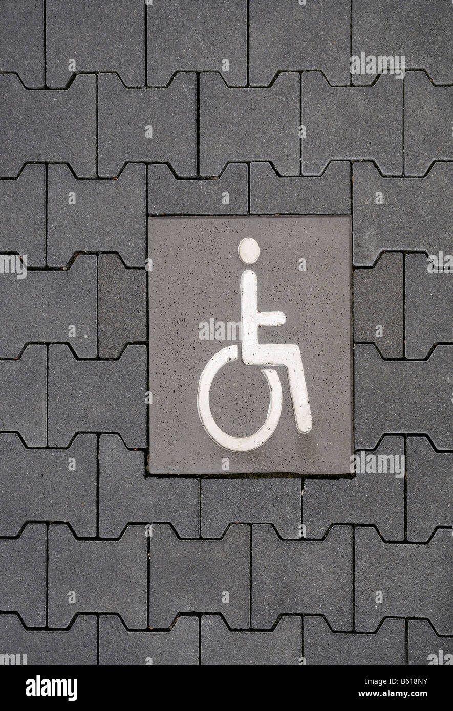 Disabled park place with wheelchair user pictogram in the paving - Stock Image