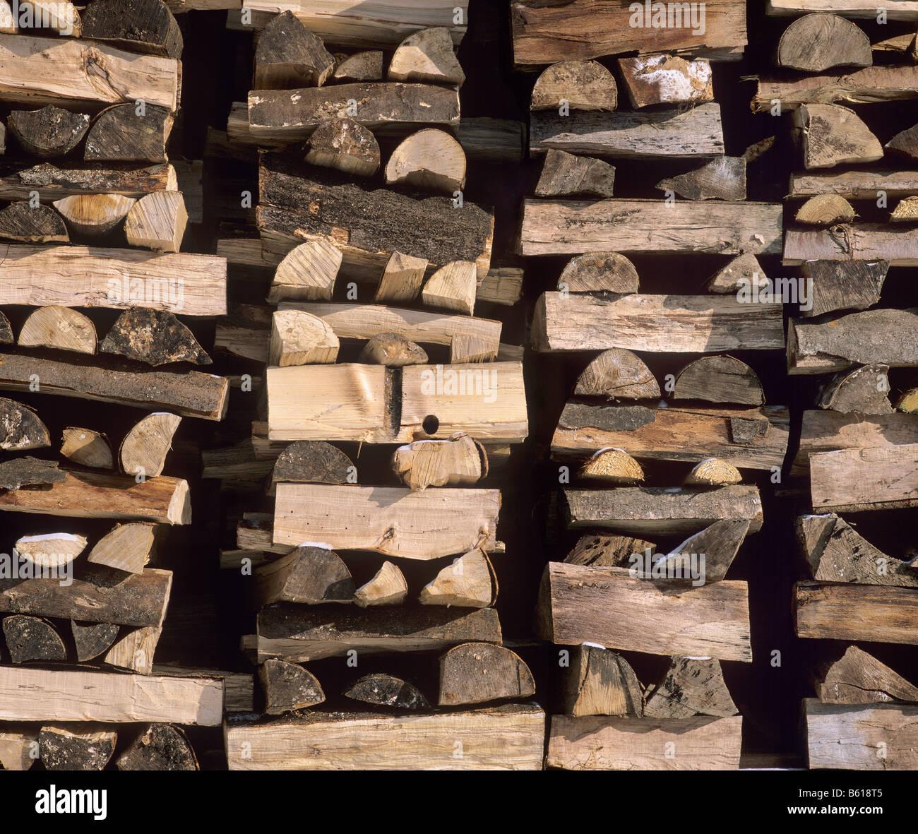 Stacked firewood, full frame - Stock Image