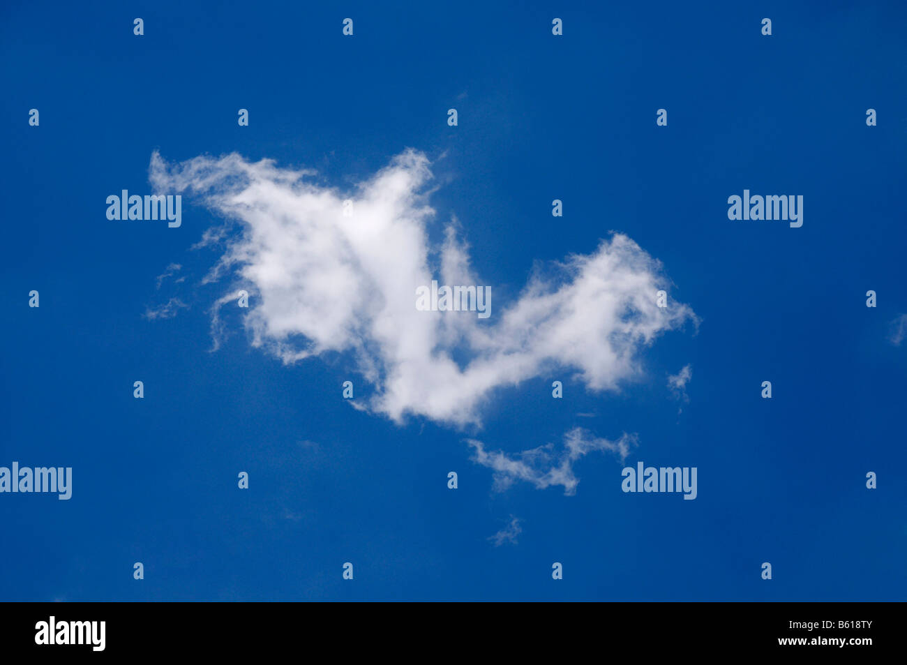 Cirrus cloud in a blue sky - Stock Image