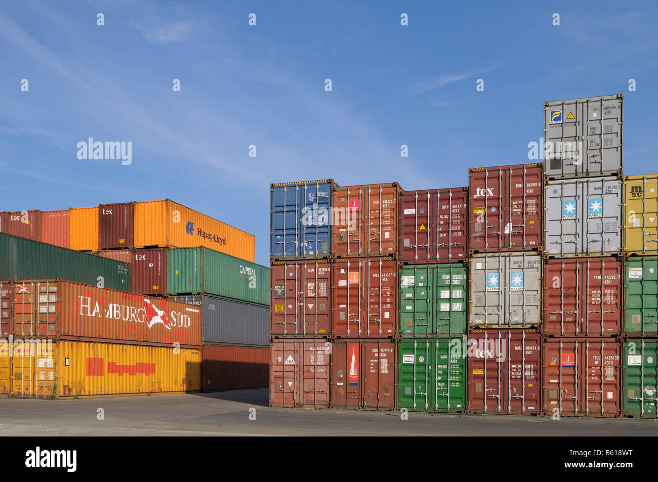 View in a container terminal, various overseas containers stacked in groups - Stock Image